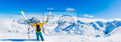 Plakat Ski in winter season, mountains and ski touring equipments on the top in sunny day in France, Alps above the clouds.