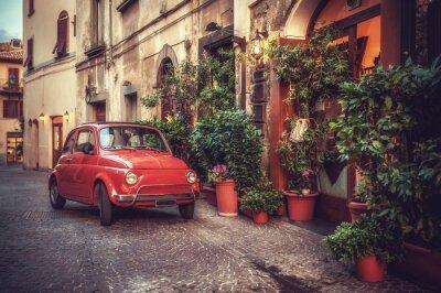 Plakat Stare zabytkowe kult samochód zaparkowany na ulicy w restauracji, w