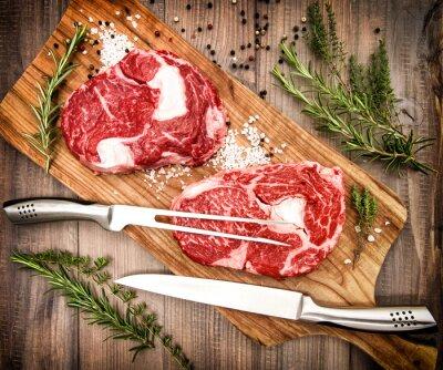 Plakat Surowe mięso świeże Ribeye Steak z ziół i przypraw. Retro styl