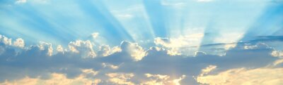 Plakat The background of sun rays over clouds. The sun rays break over the clouds.