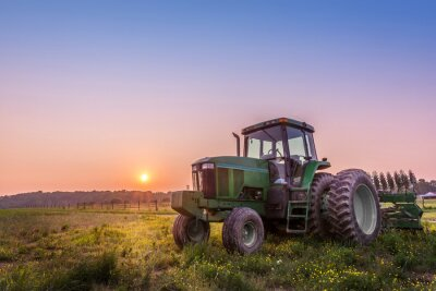 Plakat Tractor in a field on a Maryland farm at sunset