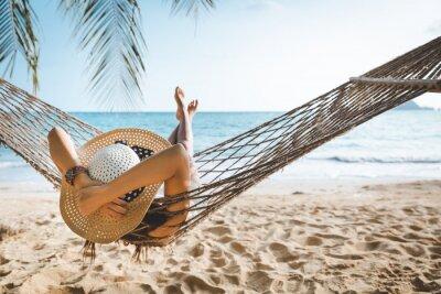 Plakat Traveler asian woman relax in hammock on summer beach Thailand