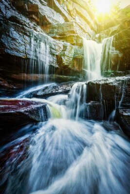 Plakat Tropical waterfall with sun rays