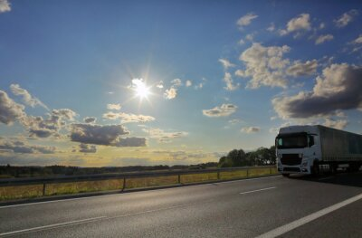 Truck transport on the road and cargo at sundet