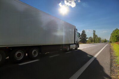 White truck transport on the road at sunset and cargo