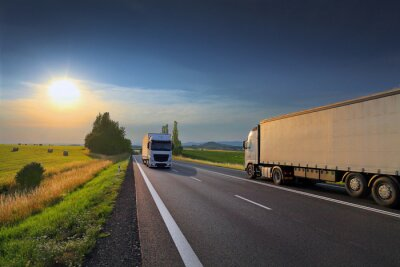 White trucks transport on the road  at sunset and cargo