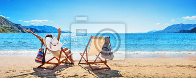 Plakat Woman Enjoying Sunbathing at Beach