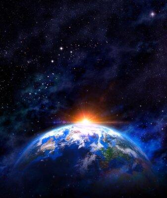 Plakat wschód słońca nad ziemi w przestrzeni kosmicznej