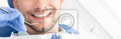 Plakat Young man at the dentist