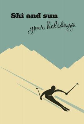 Plakat Zima w tle. Narciarz slajdy z góry.