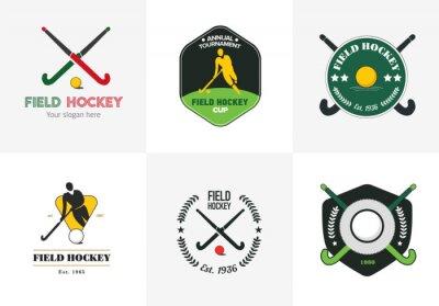 Tapeta Hokej ustawić logo. Wektor odznaki sportowe z człowiekiem sylwetka, kijem i piłką.