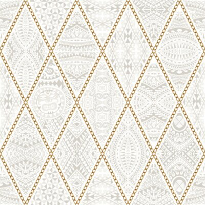 Tapeta Seamless pattern with golden chains, rings, patchwork from beige ornate rhombus with Maori tattoo ornaments on a white background. Batik fashion collection, wallpaper, textile monochrome print